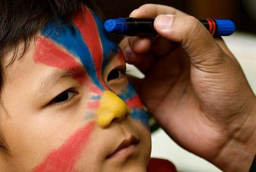 Tibetan flag on kid's face